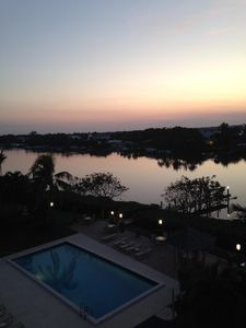 Photo for 5 th floor condo overlooking pool and intercoastal , patio on southern exposure.