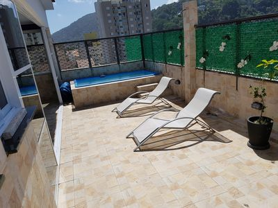 Photo for COVERAGE WITH POOL AND BARBECUE - GUARUJÁ