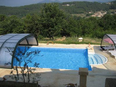 Photo for Luxurious, well appointed flat for 4 with solar heated pool, garden, sauna, view