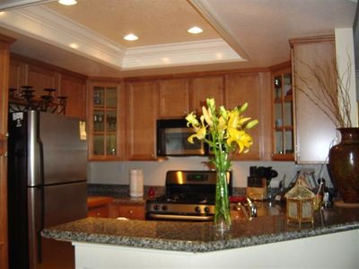 Photo for Tasteful Decor corp or vacation rental. Pool, tennis, priv balc. Green complex