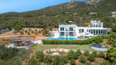 Photo for 7 BR luxury villa in Es Cubells with stunning sea view, 14 pax