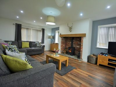 Comfortable, spacious lounge with log burner