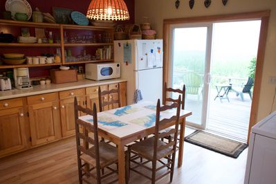 Kitchen leads out to the deck.  You can sit in the kitchen, deck or dining room.
