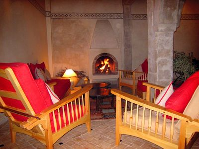 Seating in front of the open log fire
