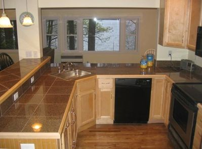 Designer Kitchen with raised counter / bar and great lake views