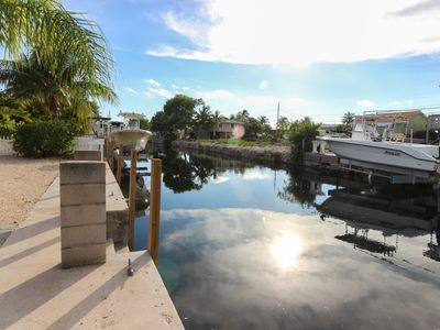 Photo for Cozy canal-front house w/ deck and boat launch - close to beaches and state park