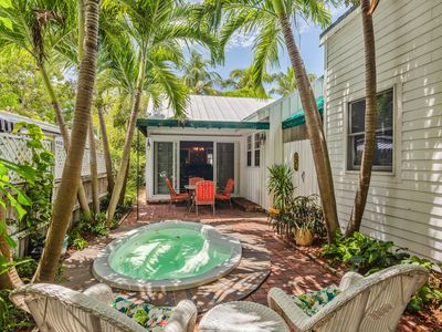 Photo for Stunning home near beach and town with private hot tub and shared pool - dogs OK