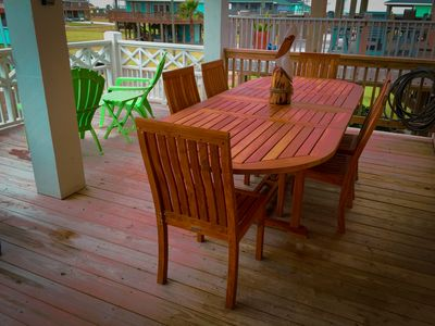 Dine on the upper deck on the oversize teak table.