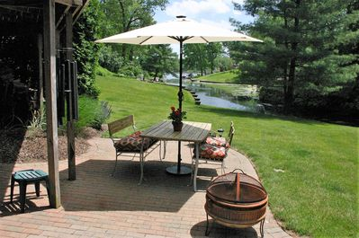 View from guest patio to Turkeyfoot Lake and State Park public beach.
