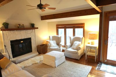 Main level living room with wood burning fire