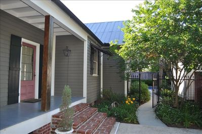 Acadian style home with private courtyard.