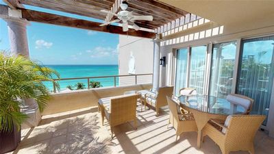 Photo for Elegant Ocean View Apartment steps from 7 Mile Beach located at The Ritz-Carlton