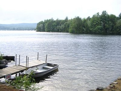 Ready for swimming or fishing with private dock and a sandy beach!