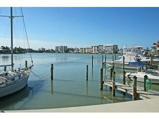 Photo for Harbour Lights Bayfront Condo. 5 minute walk to the Moorings beaches and shops.
