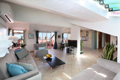 Open space living room 50 sqm large with stunning views on Mt. Etna, the histori