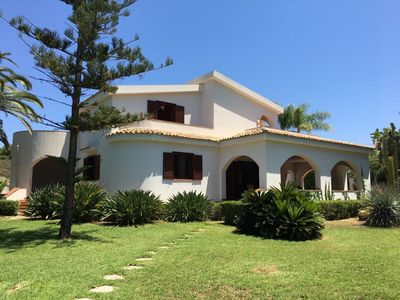 Photo for Spacious sunny Villa with large garden and private sea access