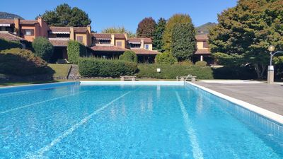 Photo for Apartment in parkland with swimming pool, tennis court and private beach