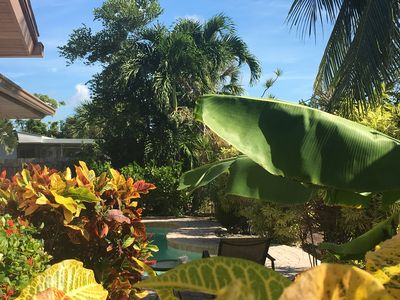 Photo for Tranquil Waterfront, Private Dock & Pool Home, Walk to beach, Lushly Landscaped