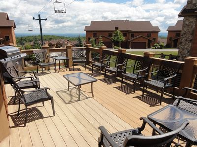 Expansive back deck with scenic mountaintop views.  Gas grill & seating for 10.
