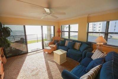 Relax in the spacious living room w/new couch & love seat.