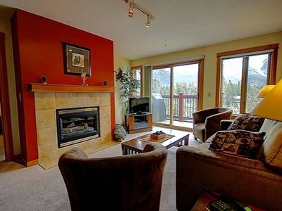 Bright living area with gas fireplace and hide-a-bed