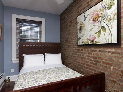 Cozy bedroom with brick exposed wall for a homey feel