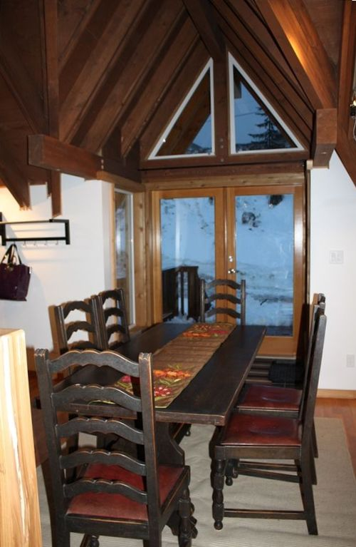 Dining Room And Door Leading To Ski SlopesKids Can Toboggan Past The Back
