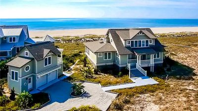 Photo for Uninterrupted ocean views from open decks and a screened porch are breathtaking.