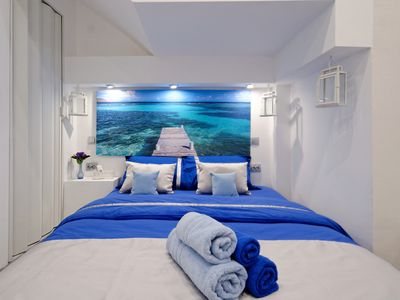 Photo for Santorini Style in Athens Plaza Luxury's Apartments