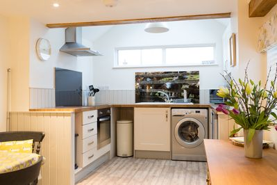 Loads of worktop space in a country style kitchen area makes cooking easy to do.