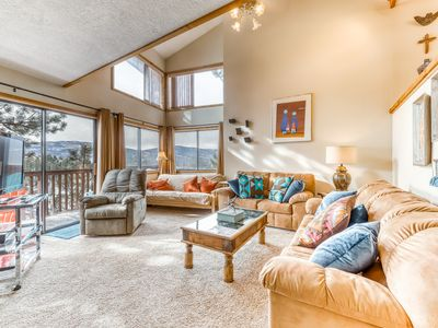 Photo for Stylish corner condo with views, jetted tub, resort access, and free WiFi!
