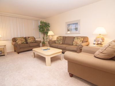 Photo for Lovely ground floor condo- beach & pool views, BBQ, shuffleboard, pool