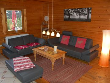 Holiday house with large grounds, private landing stage, small beach and boat