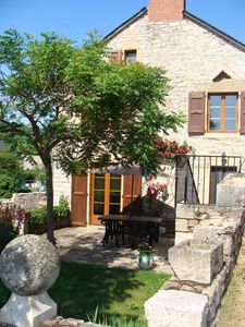 Photo for Stone holiday house in the heart of the village of Bertholène