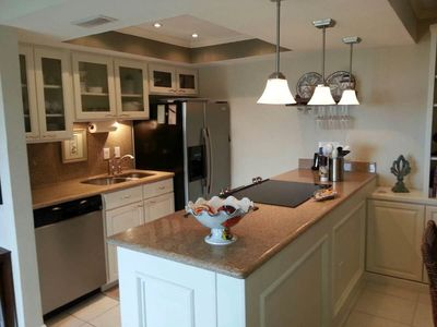 Kitchen with upgrade appliances and granite counter tops