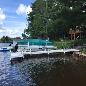 Private dock and boat lift on Eagle River Chain