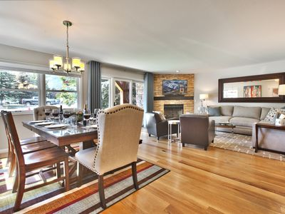 Open concept main level with huge ski run views with fireplace, HDTV & seating