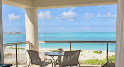 Photo for Amazing Grace Bay Beach and sunset view....TOP FLOOR!