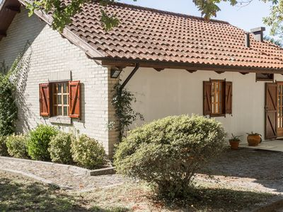 Photo for Lovely wooden house with 5 acres of outdoors, located in a small rural village