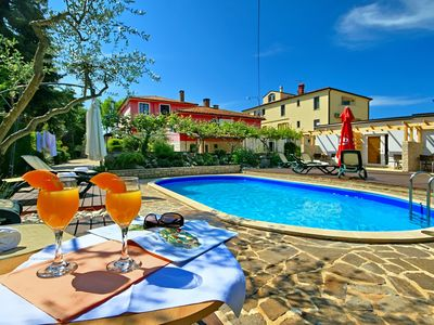 Photo for Holiday apartment with outdoor pool and barbecue