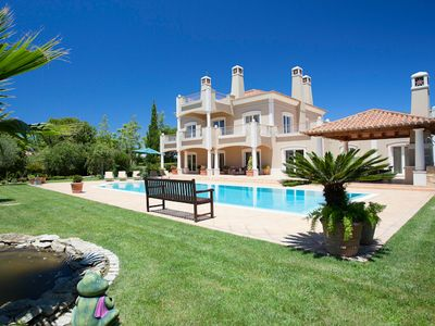 Photo for 5 bedroom Villa, sleeps 12 with Air Con, FREE WiFi and Walk to Beach & Shops