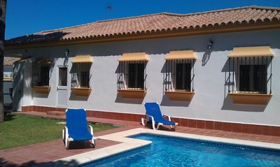 Photo for Quality 4 bedroom Villa with pool, secluded garden near golf/beach