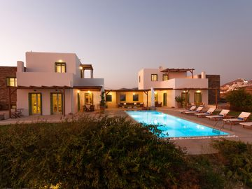 Two stylish villas linked by a pool with breathtaking sea views