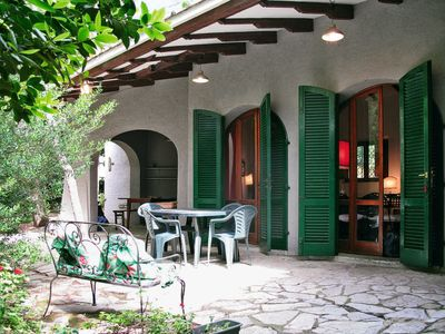 Photo for 4 bedroom Villa, sleeps 12 with WiFi and Walk to Beach & Shops