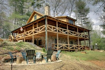 Enjoy 3 levels of this spacious Cabin & 3 Fireplaces -View from Backyard