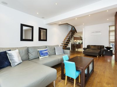 Photo for Family home, with garden and roof terrace, in residential Putney (Veeve)