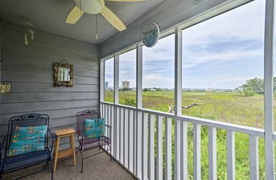 Sit on the screened-in porch and watch the birds fly in the sky!