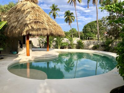 Caribbean style palapa bar. We have the honour system at the bar.