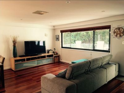 Photo for Quiet, Comfortable + Close to CBD - Business, family & pet friendly! Breakfast