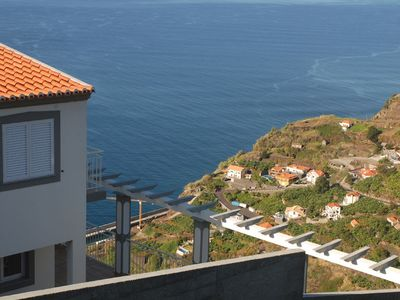 Photo for Perched high on the cliff overlooking Calheta with the most beautiful views